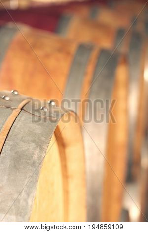 Closeup of wine casks in cellar