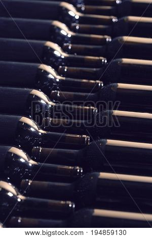Full frame shot of bottles arranged in wine cellar
