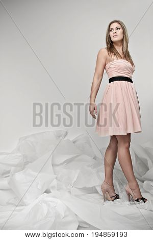 Woman in dress is standing in paperchaos