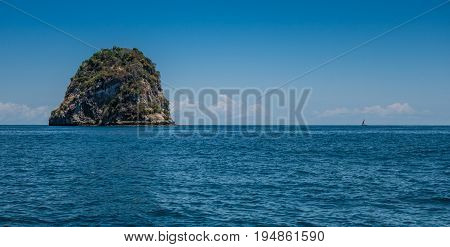 Blue water in Nosy Iranja with a wooden sailboat Madagascar