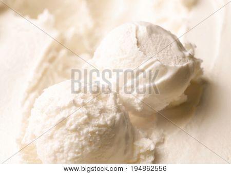 Tasty homemade vanilla ice cream scoops, closeup