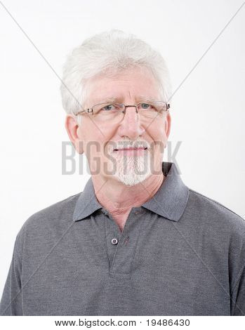 portrait of a smiling senior man over white