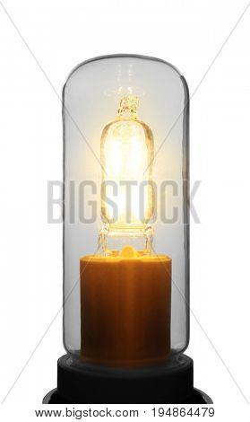 Light bulb on grey background, close up