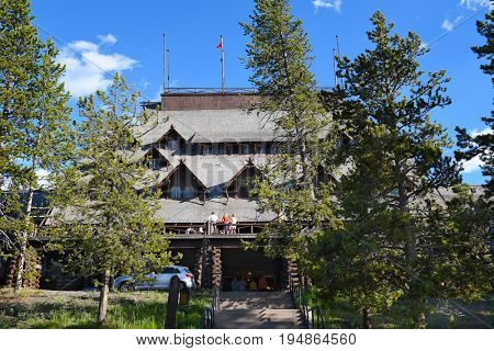 YELLOWSTONE NATIONAL PARK, WYOMING - JUNE 25, 21017: Old Faithful Inn. One of the most famous and historical hotels in Yellowstone began welcoming guests in June of 1904.