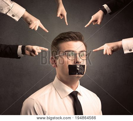 Multiple caucasian hands pointing at business male employee