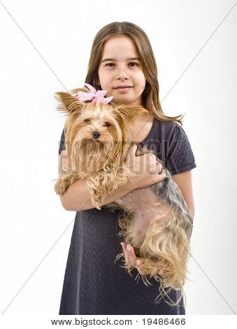 Young girl  holding a Yorkshire terrier dog isolated on white