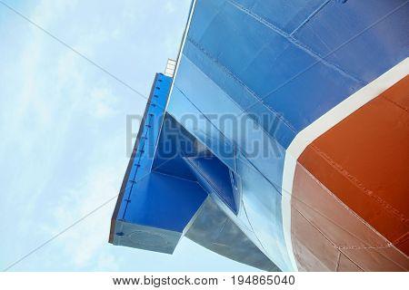 Part of modern ship against blue sky