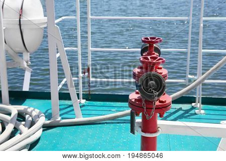 Fire hydrant on ship deck in sunny day