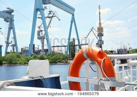 Flotation ring onboard the vessel in river port