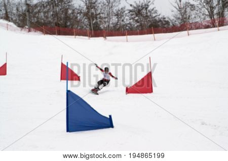Blurred View Of Snowboarding Giant Slalom Competitions