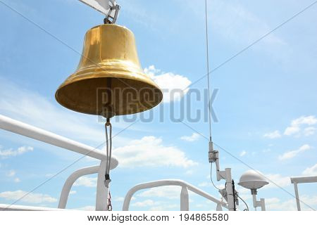 Ship bell against blue sky