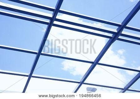 View of blue sky through transparent enclosure of modern vessel