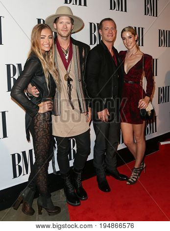 NASHVILLE, TN-NOV 3: (L-R) Brittney Kelley, Brian Kelley, Tyler Hubbard and Hayley Hubbard attend the 63rd annual BMI Country awards at BMI on November 3, 2015 in Nashville, Tennessee.