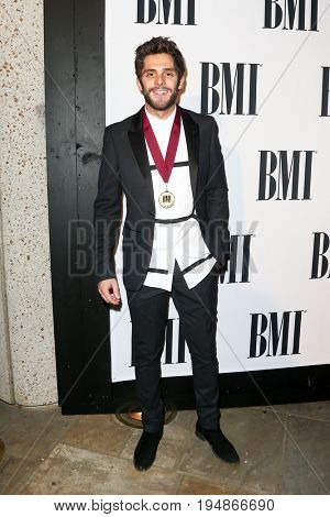 NASHVILLE, TN-NOV 3: Recording artist Thomas Rhett attends the 63rd annual BMI Country awards at BMI on November 3, 2015 in Nashville, Tennessee.