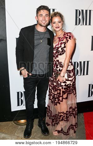 NASHVILLE, TN-NOV 3: Recording artist Michael Ray (L) and guest attend the 63rd annual BMI Country awards at BMI on November 3, 2015 in Nashville, Tennessee.