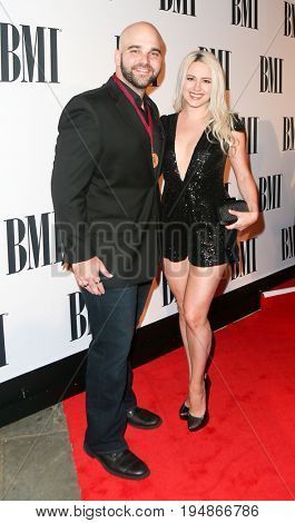 NASHVILLE, TN-NOV 3: Recording artist Johnny Bulford (L) and Janell Wheeler attend the 63rd annual BMI Country awards at BMI on November 3, 2015 in Nashville, Tennessee.