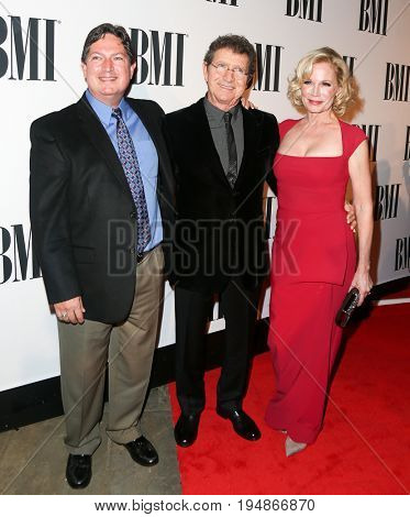 NASHVILLE, TN-NOV 3: (L) Scott Davis, Mac Davis (C) and Lise Kristen Gerard attend the 63rd annual BMI Country awards at BMI on November 3, 2015 in Nashville, Tennessee.