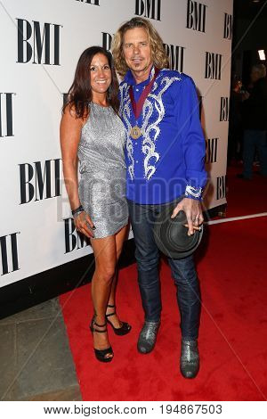 NASHVILLE, TN-NOV 3: Recording artist Jeffrey Steele (R) and wife Stephanie LeVasseur attend the 63rd annual BMI Country awards at BMI on November 3, 2015 in Nashville, Tennessee.