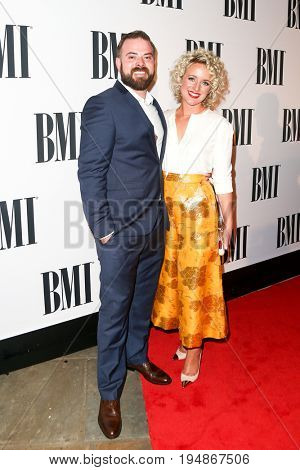 NASHVILLE, TN-NOV 3: Recording artist Cam (R) and Adam Weaver attend the 63rd annual BMI Country awards at BMI on November 3, 2015 in Nashville, Tennessee.