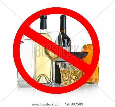 Different alcohol drinks in glassware with STOP sign on white background