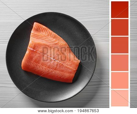 Salmon color lineal and fish fillet on plate