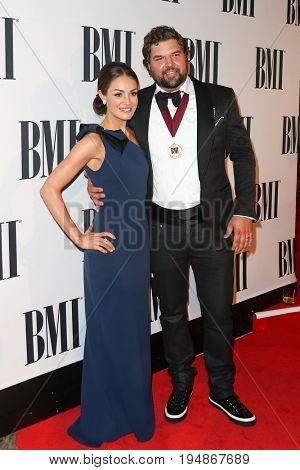 NASHVILLE, TN-NOV 3: Recording artist Dallas Davidson (R) and Natalia Starzynski attend the 63rd annual BMI Country awards at BMI on November 3, 2015 in Nashville, Tennessee.