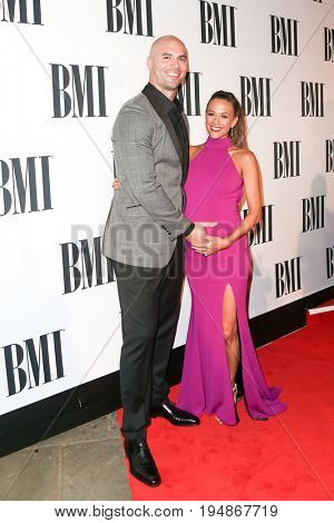 NASHVILLE, TN-NOV 3: Recording artist Jana Kramer (R) and husband Mike Caussin attend the 63rd annual BMI Country awards on November 3, 2015 in Nashville, Tennessee.