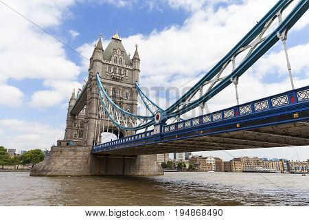 Tower Bridge on the River Thames London United Kingdom. The bridge is a symbol of the city and a great attraction for tourists