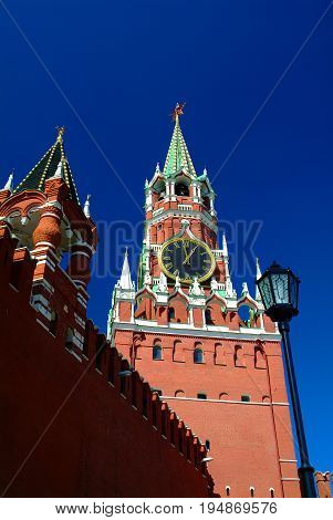 View on Moscow Red Square Kremlin tower Spasskaya Bashnya with Chiming Kuranti Clock. Moscow Kremlin Red Square best famous sightseeing places for tourist holidays vacations tours. Famous monuments