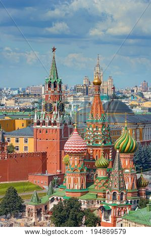 View on Moscow Red Square, Kremlin towers, stars and Clock Kuranti, Saint Basil's Cathedral church. Panorama from hotel Russia. Moscow holidays vacation tours famous sightseeing tours travel poster