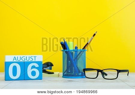 August 6th. Image of august 6, calendar on yellow background with office supplies. Summer time.