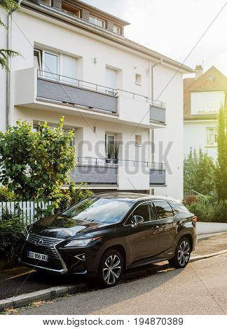 STRASBOURG FRANCE - CIRCA 2017: New Luxury Hybrid Lexus RX 450h SUV parked on a street in France