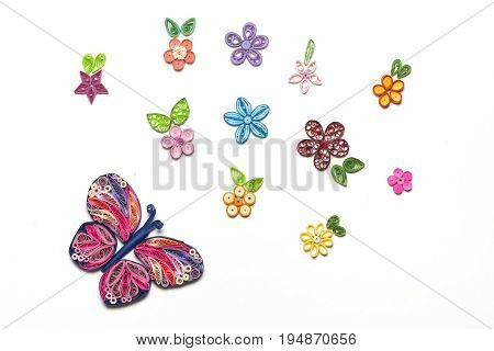 Concept of a garden made with quilling paper technique figures