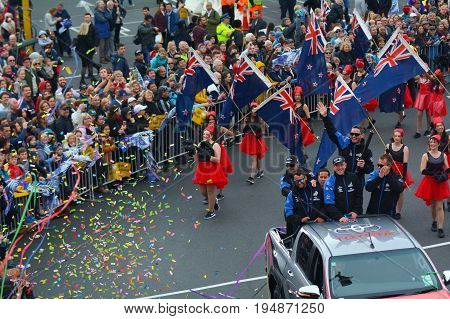 AUCKLAND - JULY 06 2017: Fans welcome home Team New Zealand and the Auld Mug America's Cup Trophy in downtown Auckland New Zealand.