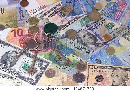 Keys cash and coins abstract money background