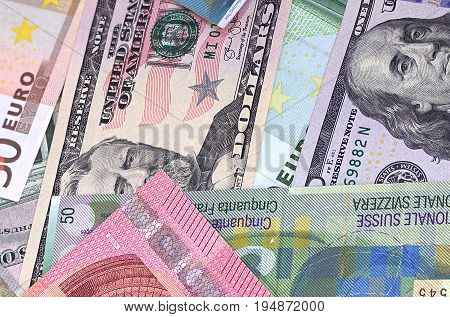 Abstract dollar euro and swiss franc background