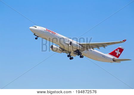 ZURICH - July 30:  A-330 Swiss airlines taking off at Terminal A of Zurich Airport on July 30, 2016 in Zurich, Switzerland. Zurich airport is home port for Swiss Air and one of the european hubs.