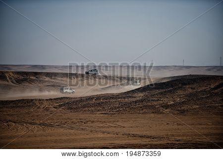 Jeep Safari In Sand Desert On Blue Sky
