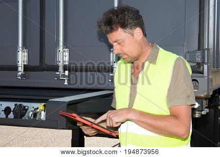 Wholesale, Logistic, Loading, Shipment And People Concept - Man Or Loader With Tablet Pc Computer An