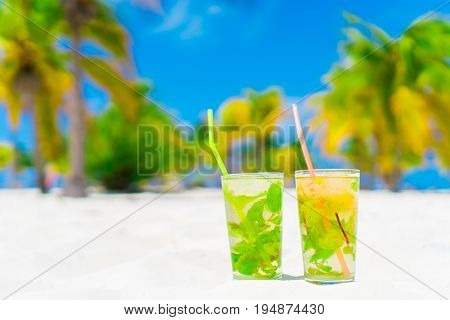 Two cold tasty mohito cocktail on the white sandy beach