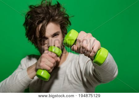 Young Guy With Barbell Doing Morning Exercise, Has Uncombed Hair
