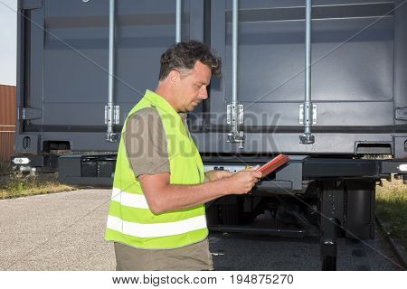 a Truck driver in working clothes yellow