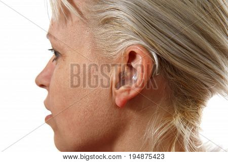 modern digital hearing aid in woman's ear