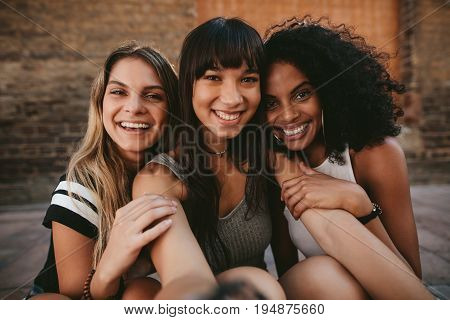 Three Beautiful Smiling Girlfriends Taking Selfie