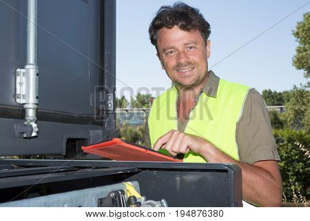 Businessman Checking Around Oil Refinery Plant And Container On Tablet