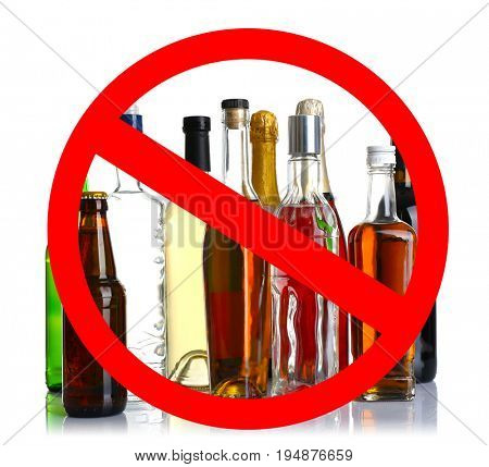 Different alcohol drinks in bottles with STOP sign on white background