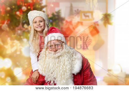 Authentic Santa Claus with little boy and teddy bear at home. Christmas and New Year celebration