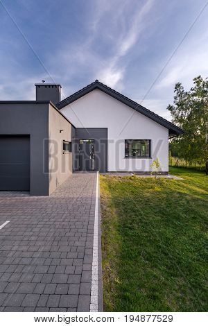 Modern House With Cobblestone Driveway
