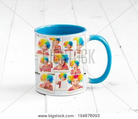Lovely cup blue on the inside with light blue handle and a print, smily clowns