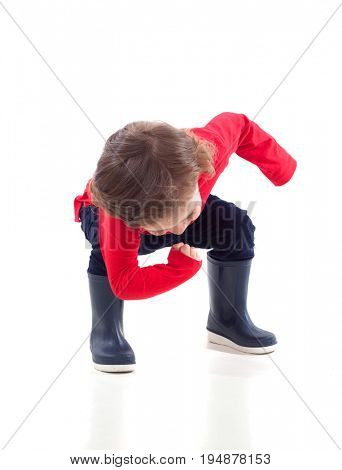 Cute little child with boots dancing isolated on a white background